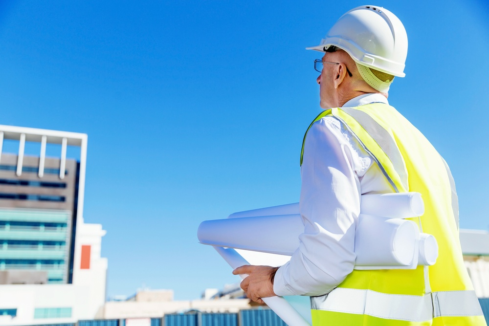 Engineer builder at construction site - shutter stock limited licence